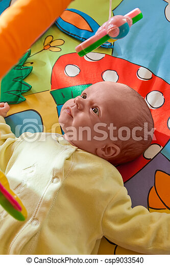 Little baby playing on mat - csp9033540