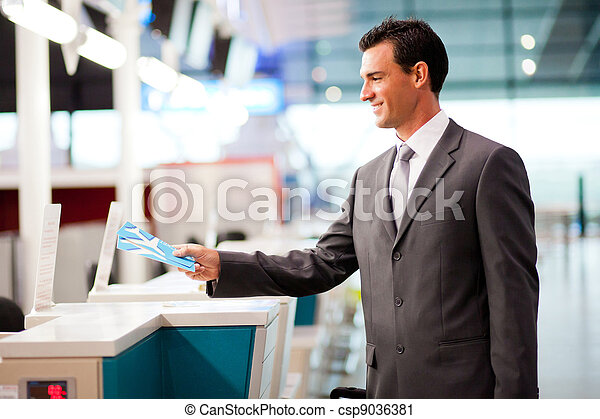 businessman at airline check in counter - csp9036381