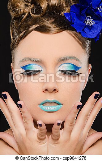 Vertical portrait of woman with blue make-up - csp9041278