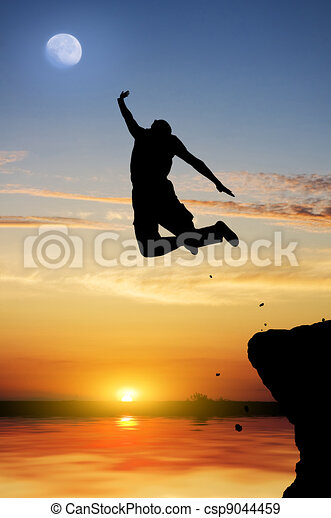 Silhouette of the person jumping on a decline - csp9044459