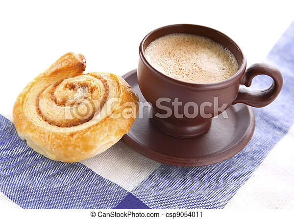 Cup of cofee with cinnamon Danish bun  - csp9054011