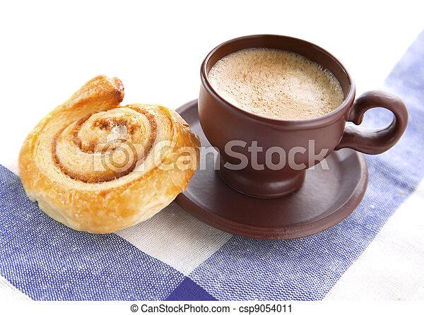 Cup of cofee with cinnamon Danish bun  - csp9054011