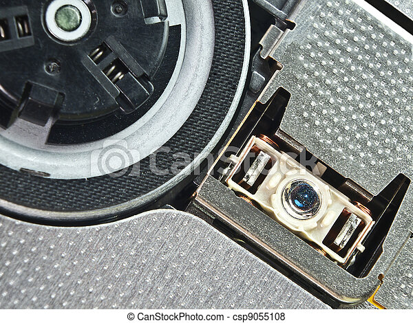 Macro photo of lens and DVD holder - csp9055108