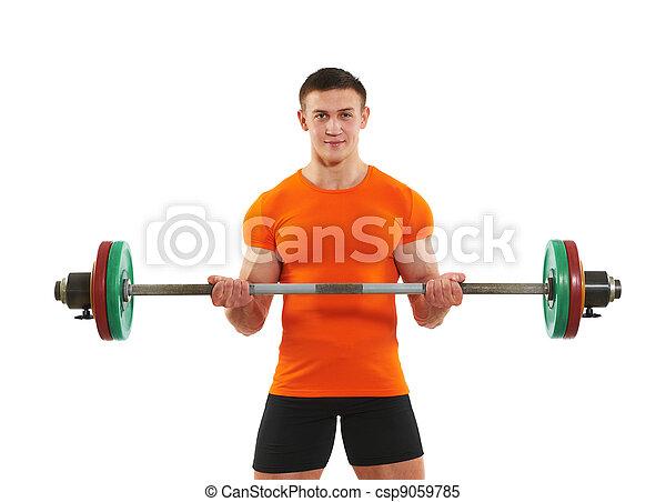 bodybuilder man doing biceps muscle exercises - csp9059785