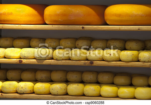 Cheese on shelves in Gouda store - csp9060288