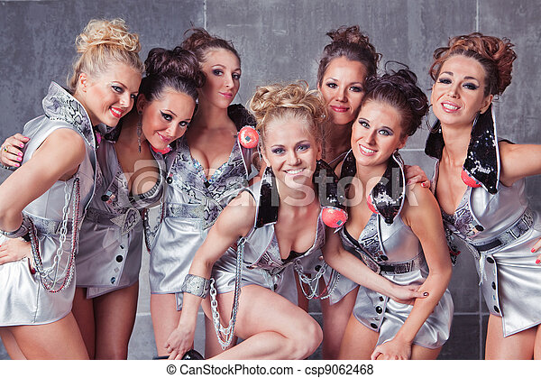 Group of seven happy smiling cute girls in silver go-go costume ready to party - csp9062468