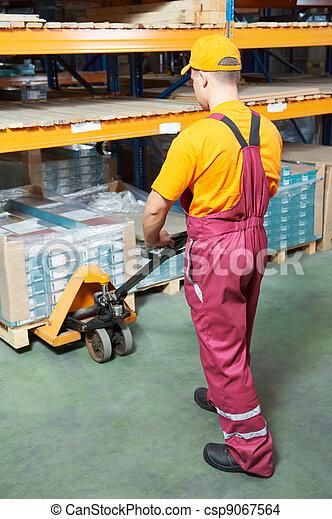 worker with fork pallet truck - csp9067564