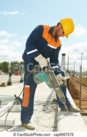 portrait of construction worker with perforator - csp9067576