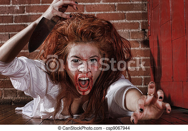 Woman in Horror Situation With Bloody Face - csp9067944
