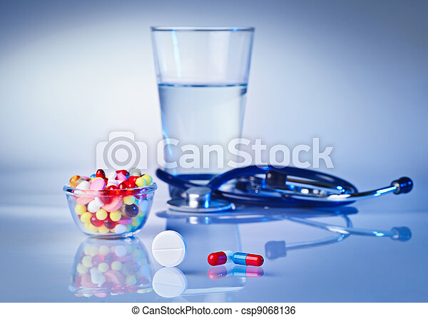 Pills and tablets macro still life on white blue, medical therapeutic concept - csp9068136