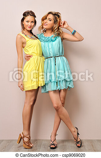 Two beautiful women in summer dresses. - csp9069020