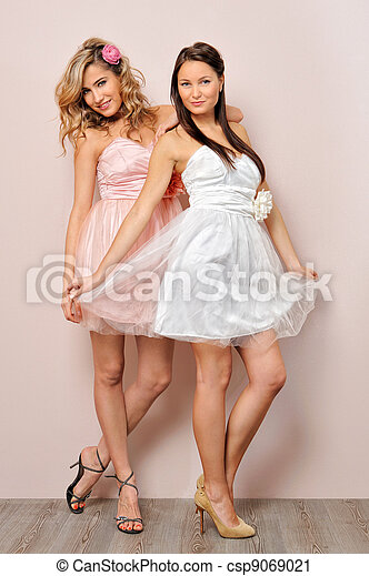 two beautiful woman in chic dresses. - csp9069021