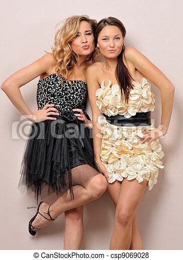 Two beautiful women in fancy dresses. - csp9069028