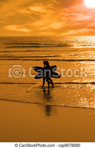angelic surfing couple silhouette - csp9076680