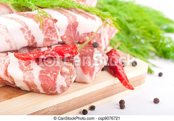 Meat rolls with fennel and red pepper on a bamboo board - csp9076721