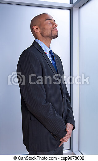 Businessman looking zen - csp9078002