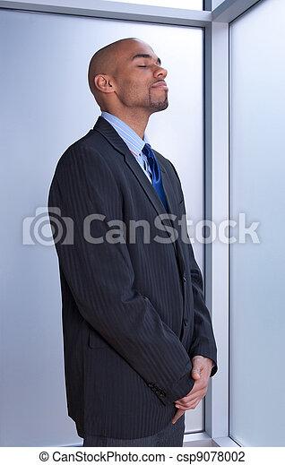 Businessman looking zen - csp9078002