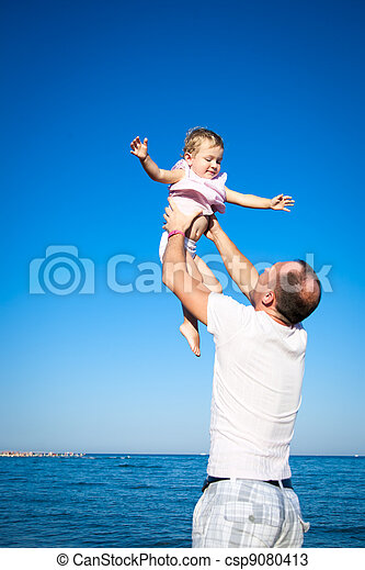 Happy child playing with father at the beach - csp9080413