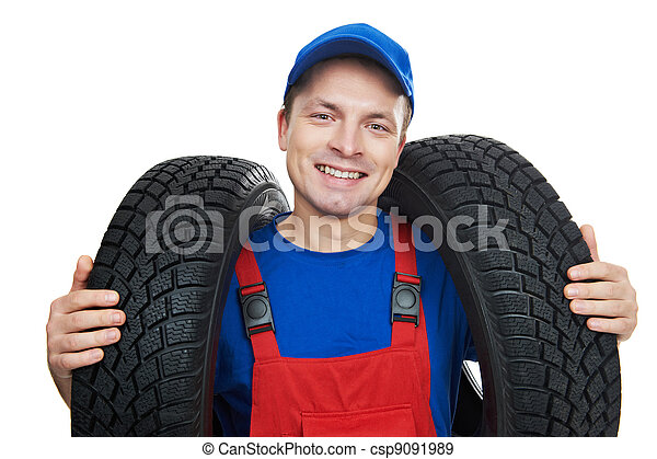 automobile mechanic with car tire - csp9091989