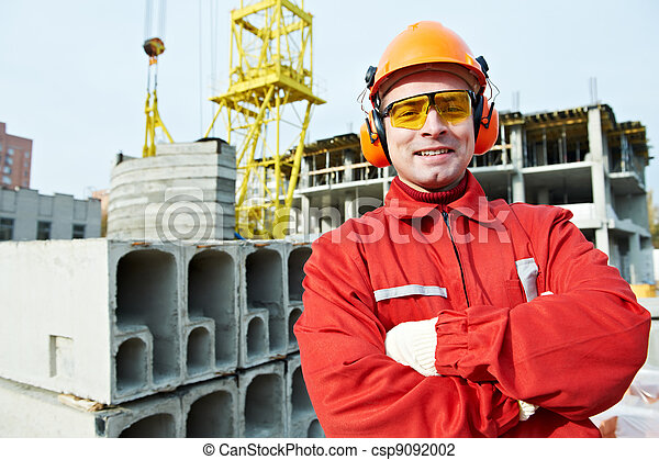 happy builder worker at construction site - csp9092002