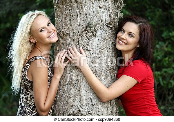 Tree Hugging Pretty Girls - csp9094368