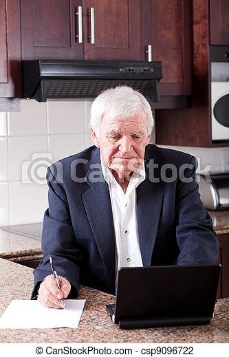 senior man doing internet banking - csp9096722
