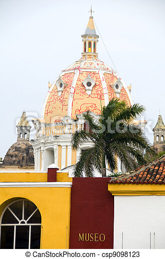 dome of Iglesia Church of Santo Domingo and Naval Museum palm tree Cartagena de Indias Colombia South America - csp9098123