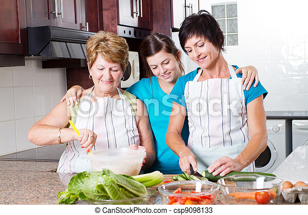 teen girl watching mother and grandmother cooking - csp9098133
