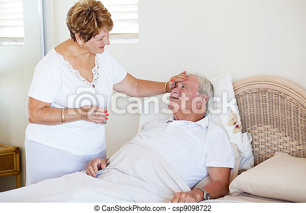 loving senior wife comforting ill husband - csp9098722