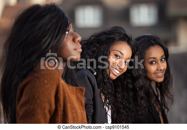 Portrait  of happy youngs african american teenage girl - csp9101545