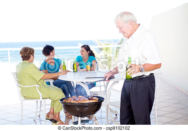 grandpa doing barbeque for the family - csp9102102
