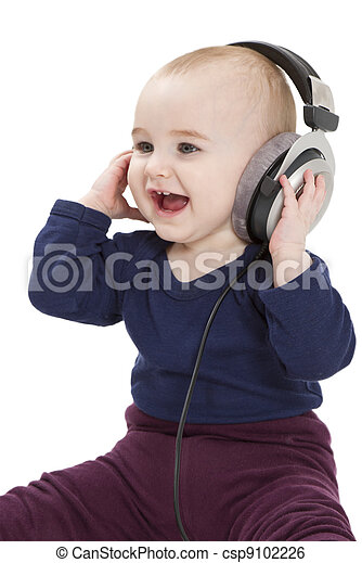 young child with ear-phones listening to music - csp9102226