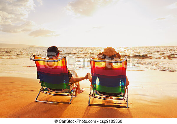Happy Romantic Couple Enjoying Beautiful Sunset at the Beach - csp9103360