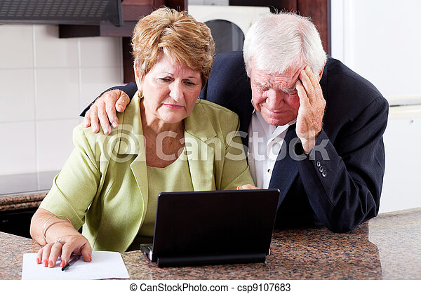 unhappy senior couple worrying about expenses - csp9107683