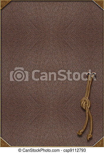 The texture of the skin with gold lettering and a rope tied in a knot - csp9112793