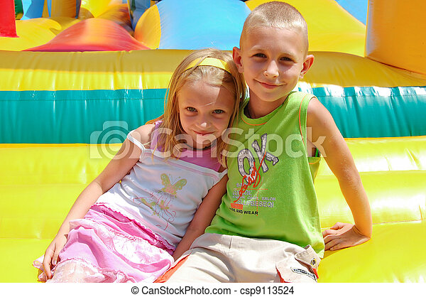 the girl and the boy in park of attractions - csp9113524