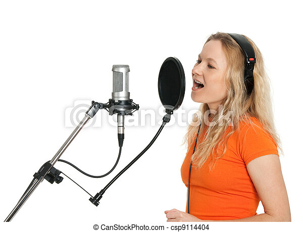 Girl in orange t-shirt singing with studio microphone - csp9114404