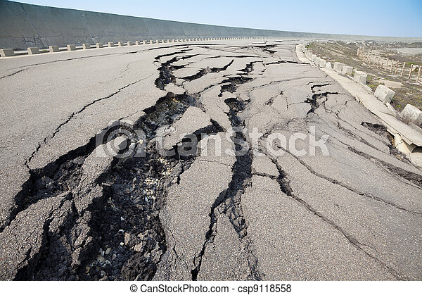 cracked road after earthquake - csp9118558