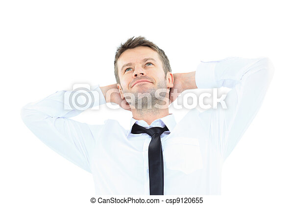 Portrait of handsome business man relaxing with hands behind head - csp9120655