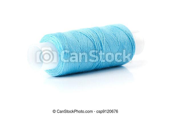 blue bobbin thread isolated on white - csp9120676