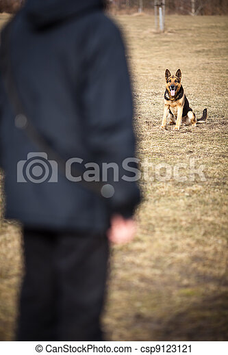 Master and his obedient (German Shepherd) dog - csp9123121