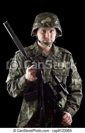 Armed soldier grasping m16 - csp9123955