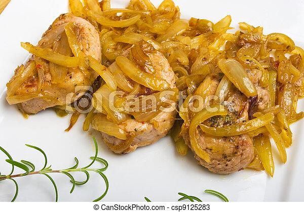 Pork sirloin steaks under onion - csp9125283
