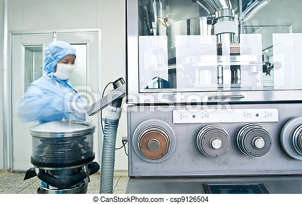Technicians working in the pharmaceutical production line - csp9126504