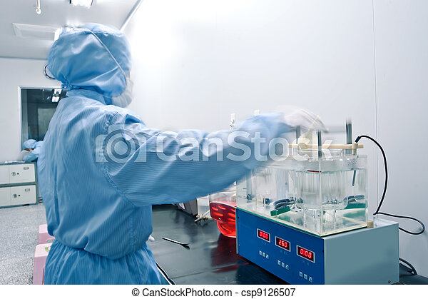 Technicians working in the pharmaceutical production line - csp9126507