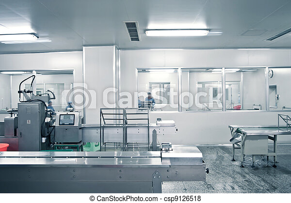 Technicians working in the pharmaceutical production line - csp9126518