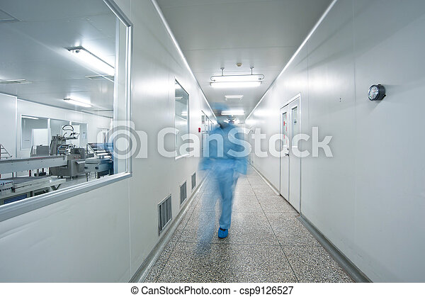 Technicians working in the pharmaceutical production line - csp9126527