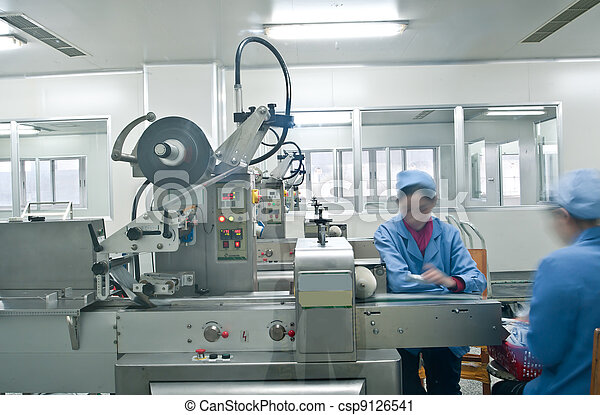 Technicians working in the pharmaceutical production line - csp9126541