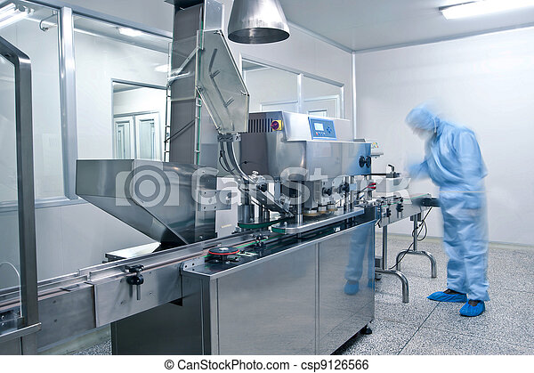 Technicians working in the pharmaceutical production line - csp9126566