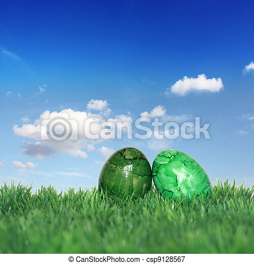 Green Easter eggs on a green meadow - csp9128567